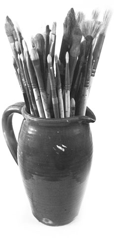 Paint brushes in an old pot